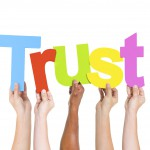 Diverse People Holding Single Word Trust