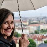 Woman Enjoying Prague in the Rain
