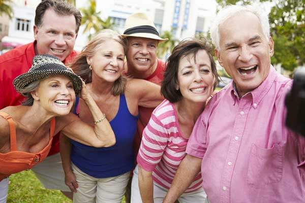 Group of happily retired people taking a picture