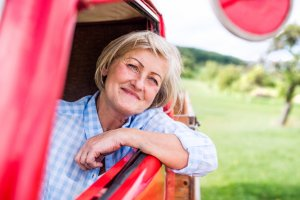 make the most of medicare Close up of senior woman in checked blue shirt inside vintage pickup truck
